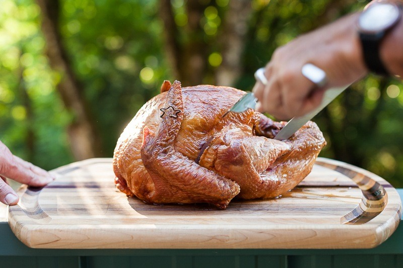 Carving a Smoked Turkey cooked on a Weber Kettle barbecue served with our 2016 vintage Three Feathers Pinot Noir.