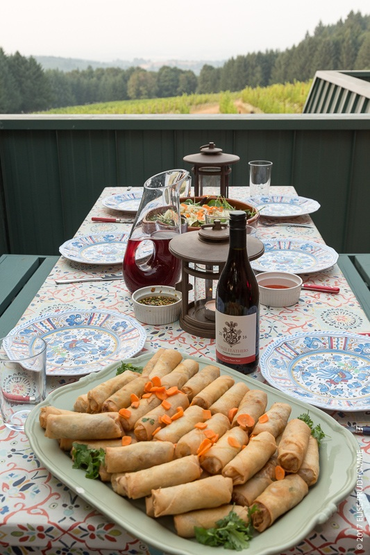 Cynthia's spring rolls served with Three Feathers Estate 2016 Pinot Noir with view of vineyards in background.
