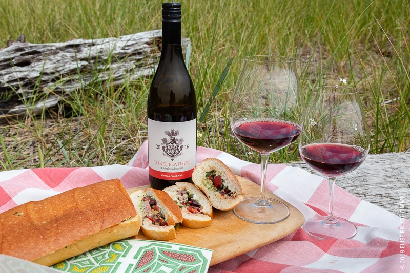 Picnic on the Oregon Coast with a Pan Bagnat sandwich and a bottle of 2016 Three Feathers Pinot Noir.  The 'Pan Bagnat' is a traditional local sandwich NICE Alpes-Maritimes French Riviera Provence-Alpes-Côte d'Azur France.