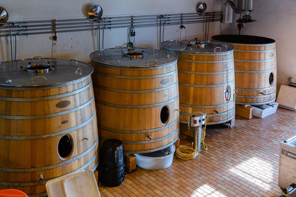 Wooden fermentation tanks for Merlot wine, Wine Estate Chateau P