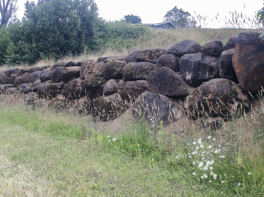 Wall made of flood boulders at Three Feathers